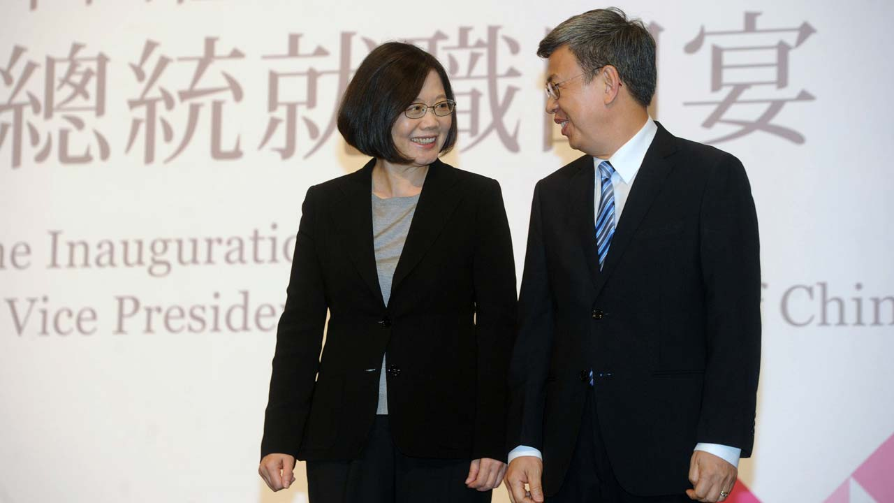 This pool picture taken and released by Taipei Photojournalists Association on May 20, 2016 shows Taiwan's new President Tsai Ing-wen (L) chatting with Vice President Chen Chien-jen during a banquet in Taipei. Taiwan's new president Tsai Ing-wen faced global scrutiny over her take on China relations as she was sworn in -- but the island's first female leader was also under the spotlight for her dress sense. POOL / AFP