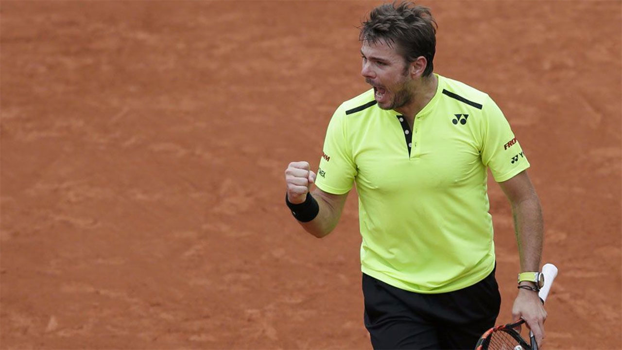 Champion Wawrinka survives Rosol scare at French Open