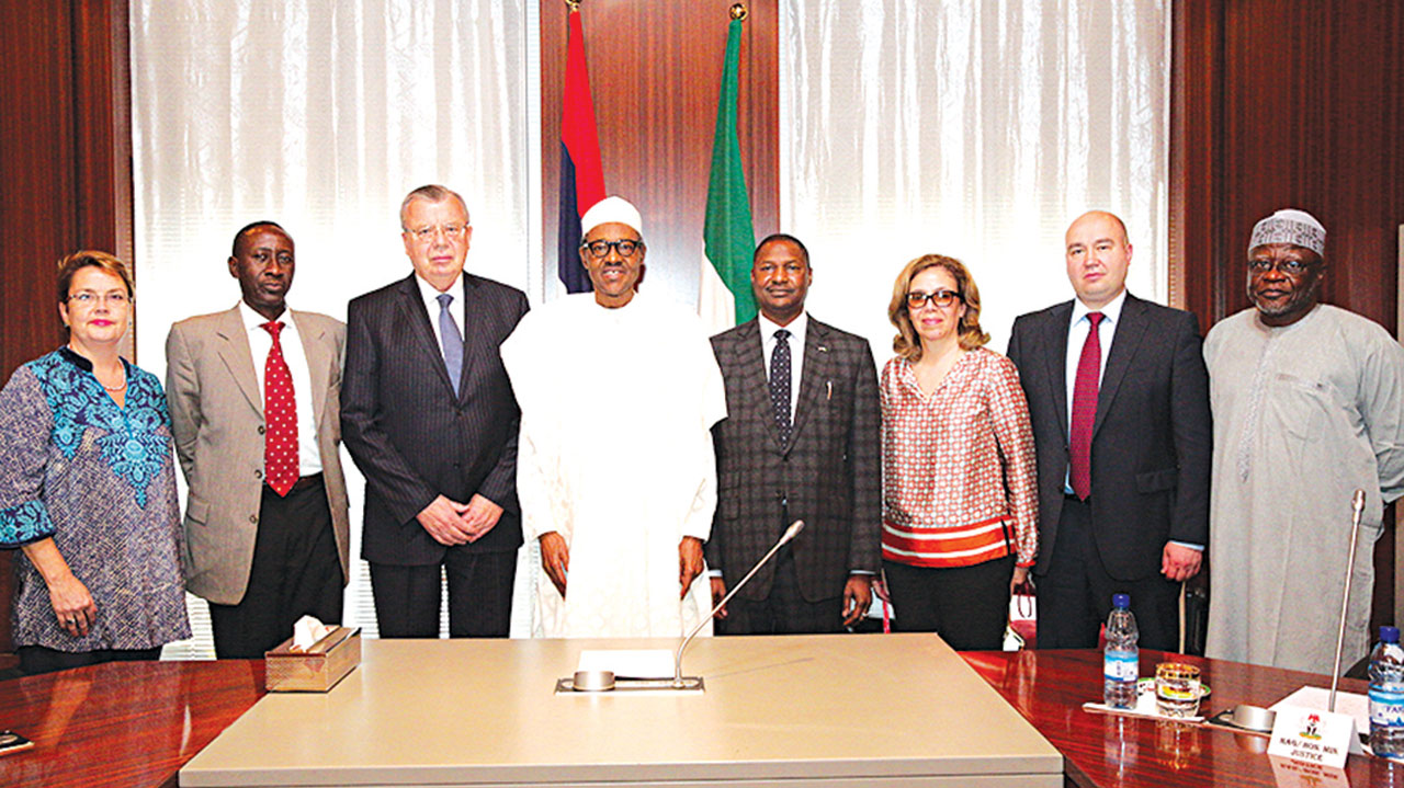 President Muhammadu Buhari in a group picture with UNODC Executive Director, Mr. Yury Fedotov and others during a courtesy visit, last week.
