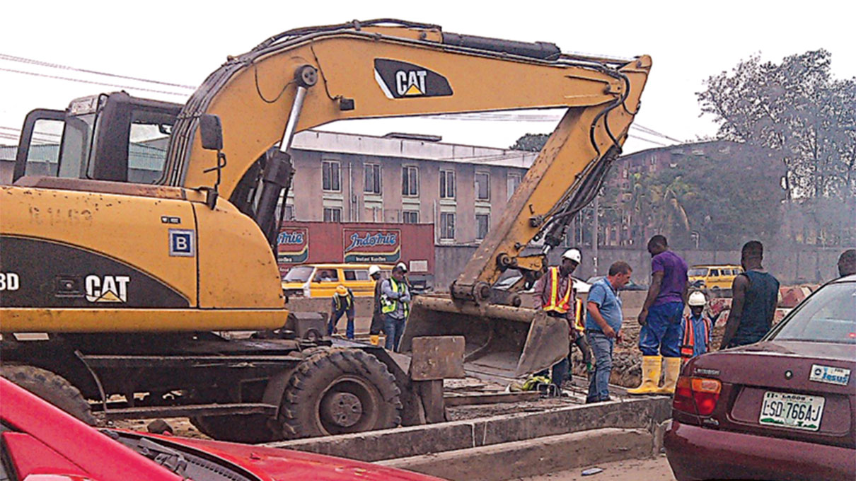 Construction workers on site PHOTOS: PAUL ADUNWOKE