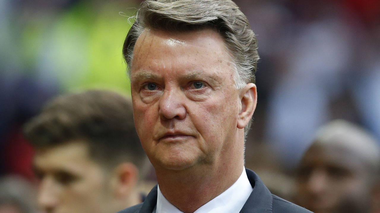 Manchester United's Dutch manager Louis van Gaal arrives for the rescheduled English Premier League football match between Manchester United and Bournemouth at Old Trafford in Manchester, north west England, on May 17, 2016. The match, originally scheduled for May 15, was called-off minutes before kick-off following the discovery of a suspect device, which turned out to be a fake bomb left in the stadium by mistake after a terror training exercise. / AFP PHOTO / Lindsey PARNABY /