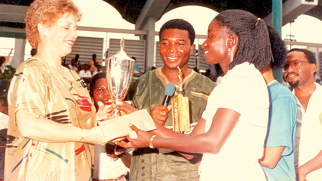 Veronica Oyibokia-Iwebema receiving the top prize after winning the All Nigeria Open Tennis Championship in Lagos