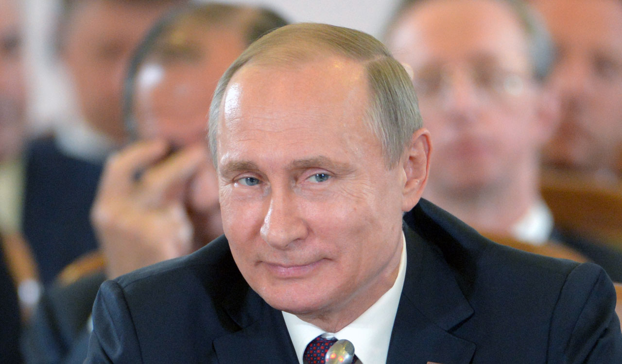 Russian President Vladimir Putin / AFP PHOTO / Host Photo Agency / -