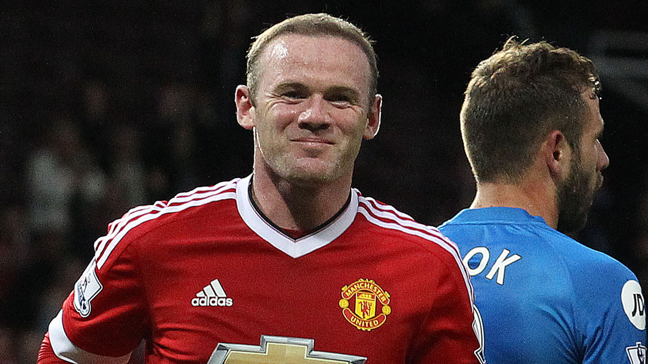 Manchester United's English striker Wayne Rooney (L) celebrates scoring his team's first goal during the rescheduled English Premier League football match between Manchester United and Bournemouth at Old Trafford in Manchester, north west England, on May 17, 2016. The match, originally scheduled for May 15, was called-off minutes before kick-off following the discovery of a suspect device, which turned out to be a fake bomb left in the stadium by mistake after a terror training exercise. / AFP PHOTO / Lindsey PARNABY /