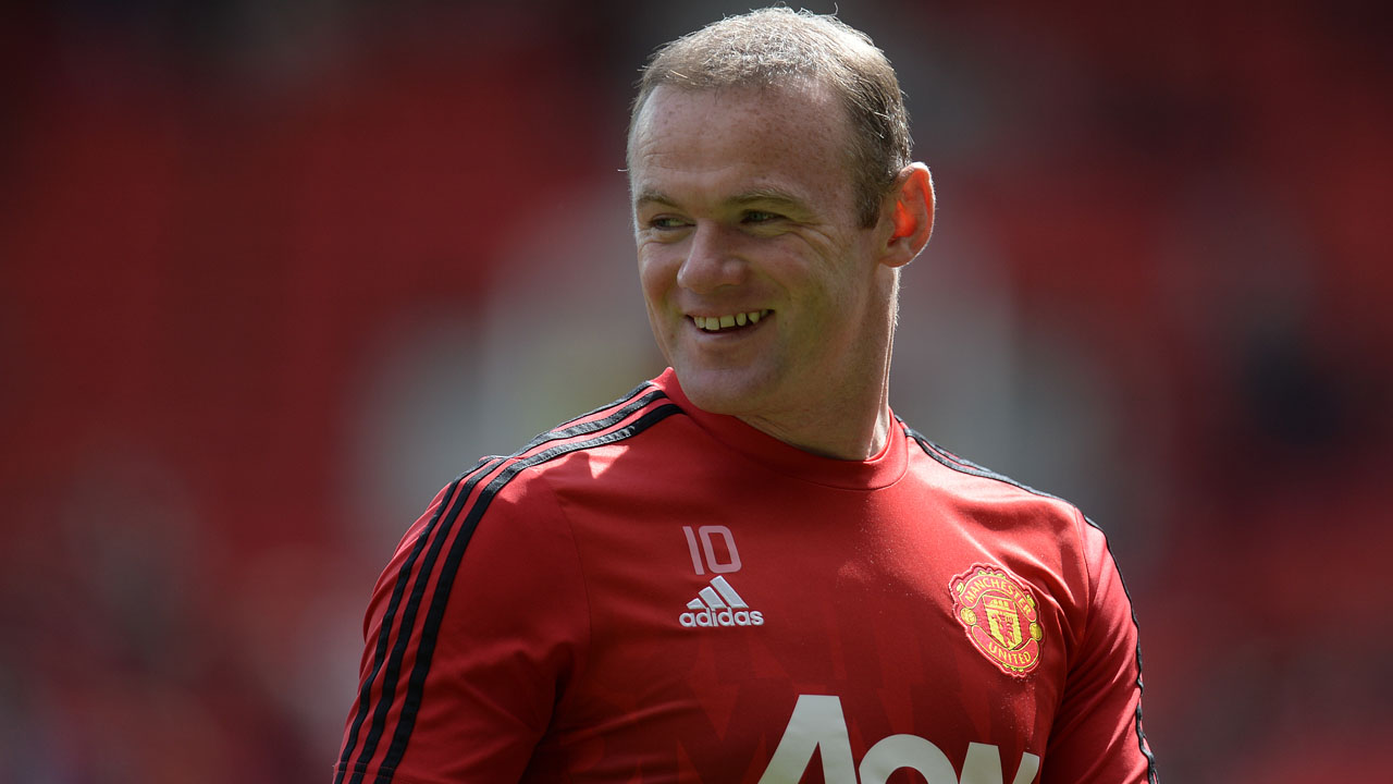 Manchester United's English striker Wayne Rooney . / AFP PHOTO / OLI SCARFF