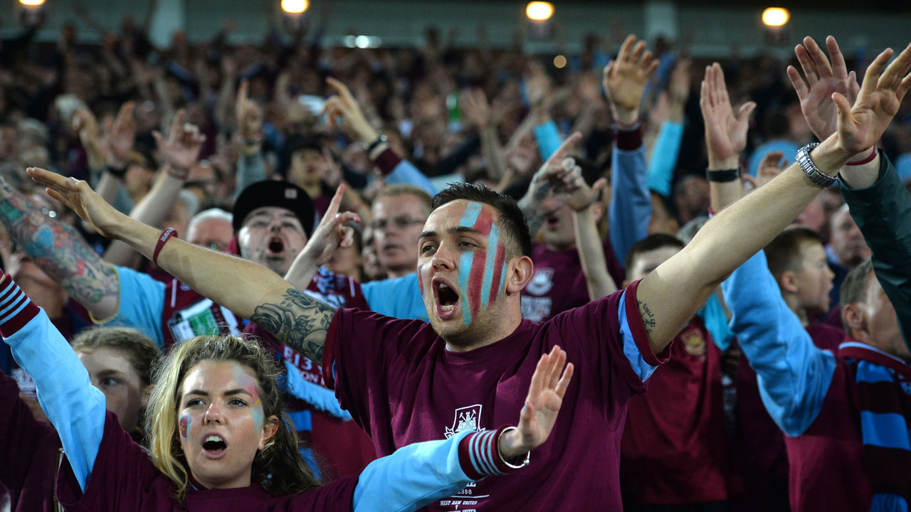 West Ham fans cheer during the English Premier League football match between West Ham United and Manchester United at The Boleyn Ground in Upton Park, in east London on May 10, 2016. / AFP PHOTO / GLYN KIRK /
