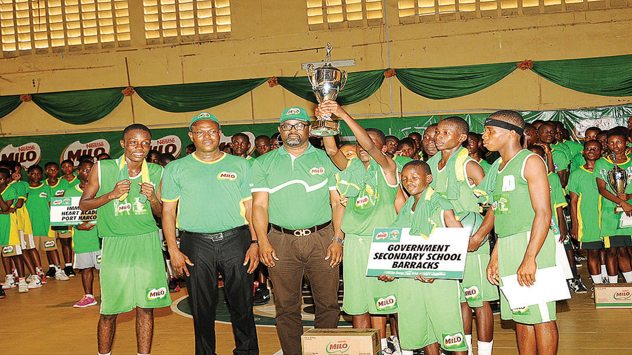 Players and officials of Government Secondary School, Barracks, Cross River State, celebrating their victory at the end of the 18th Nestle Milo Basketball Championship's Equatorial Conference in Enugu…at the weekend.