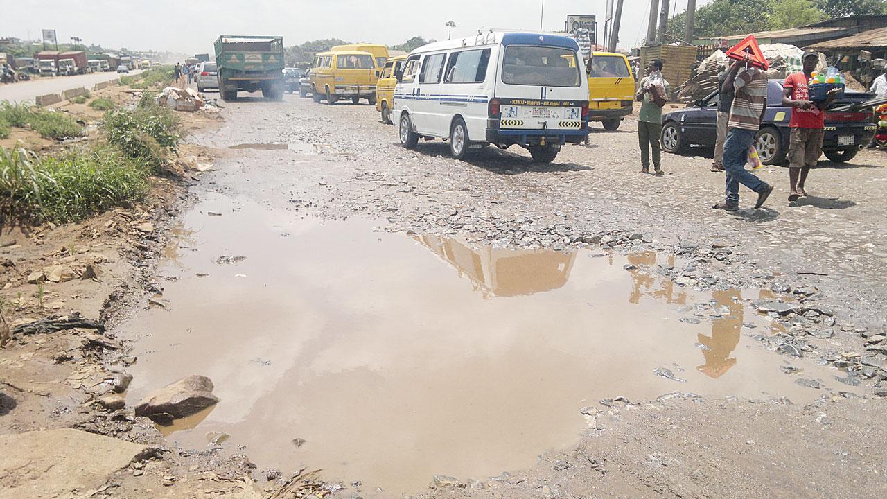 A failed section of the Sango/Owode Road PHOTO: GBENGA AKINFENWA