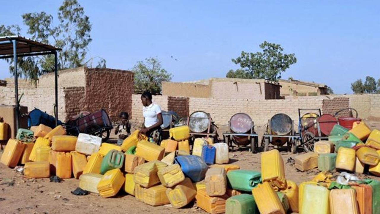 Plastic jugs are being used to collect water in the poor district of Taptenga suburb in Ouagadougou. PHOTO: AFP