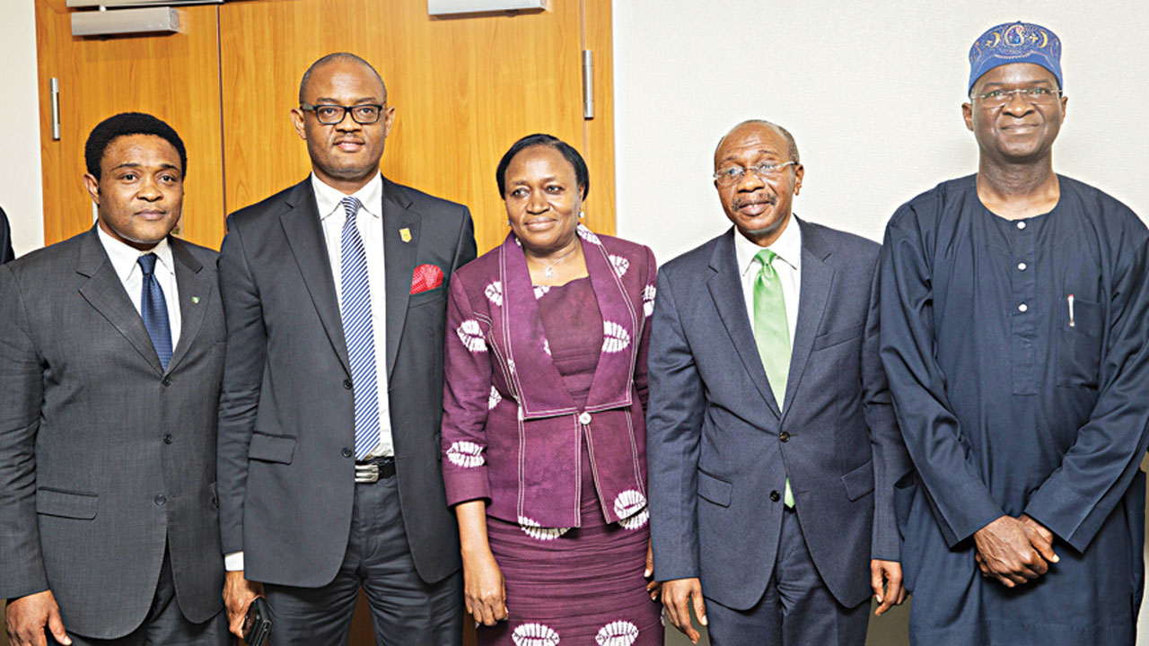 Minister of Power, Works and Housing, Babatunde Fashola (right); Governor of Central Bank of Nigeria, Godwin Emefiele; Deputy Governor, Economic, Policy, Directorate of the CBN, Dr. Sarah Alade ; Acting Chairman, Nigerian Electricity Regulatory Commission, Dr Tony Akah and Managing Director/Executive Officer of the Nigerian Bulk Electricity Trading Company (NBET), Rumundaka Wonodi during the fourth batch disbursement of the apex bank's loan to the Nigerian electricity market stabilisation facility in Lagos at the weekend