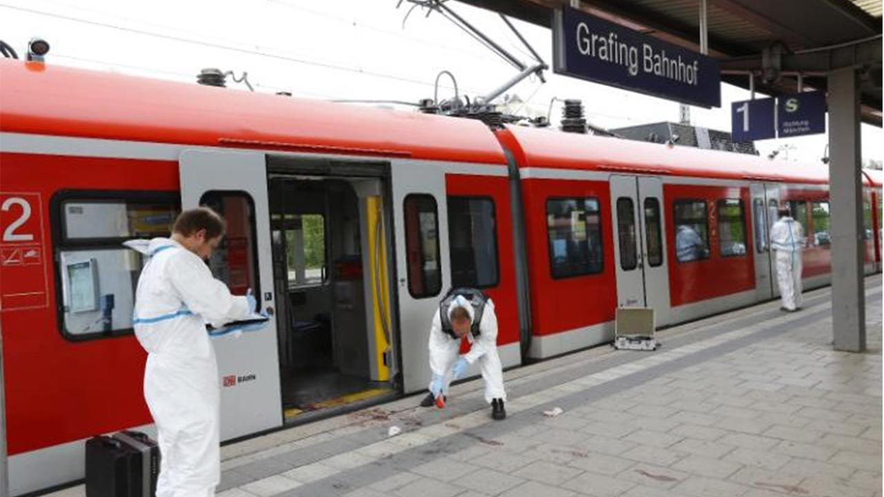 Police investigate the scene of a stabbing at a station in Grafing near Munich CREDIT: REUTERS