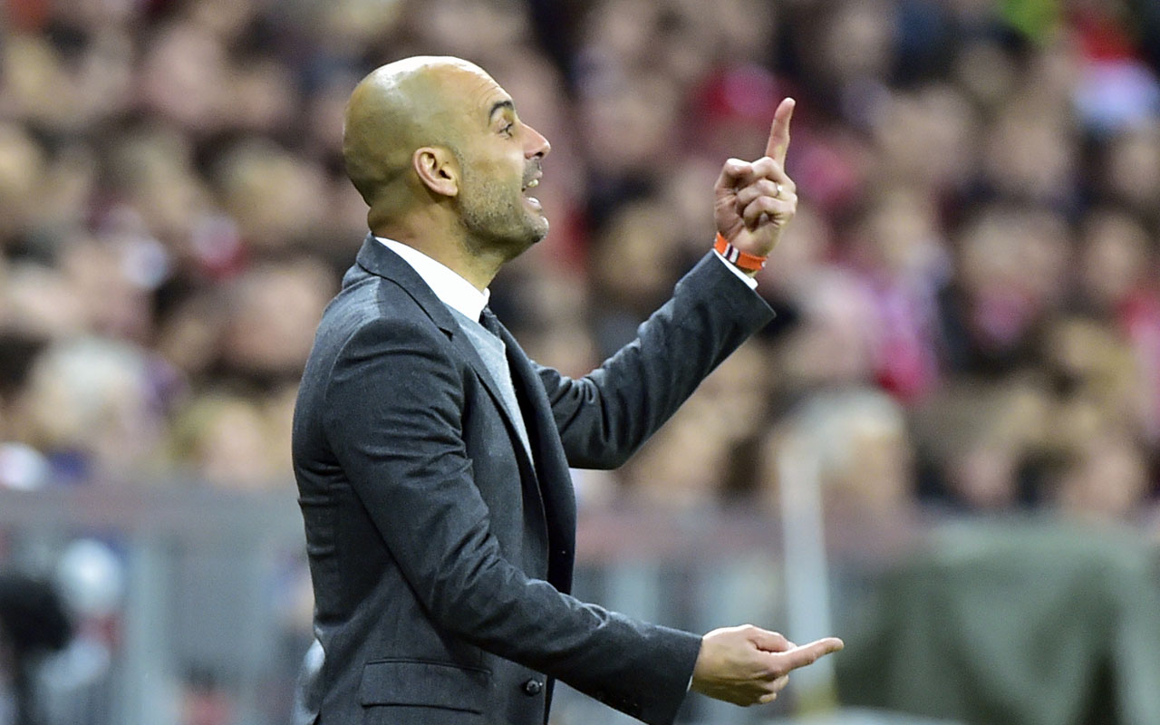 Bayern Munich's Spanish head coach Pep Guardiola gestures from the sidelines during the UEFA Champions League semi-final, second-leg football match between FC Bayern Munich and Atletico Madrid in Munich, southern Germany, on May 3, 2016. / AFP PHOTO / John MACDOUGALL