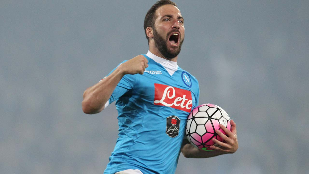 Napoli's Argentinian-French forward Gonzalo Higuain celebrates after scoring his third goal during the Italian Serie A football match SSC Napoli vs Frosinone Calcio on May 14 2016 at the San Paolo stadium in Naples. Napoli won the match 4-0. CARLO HERMANN / AFP