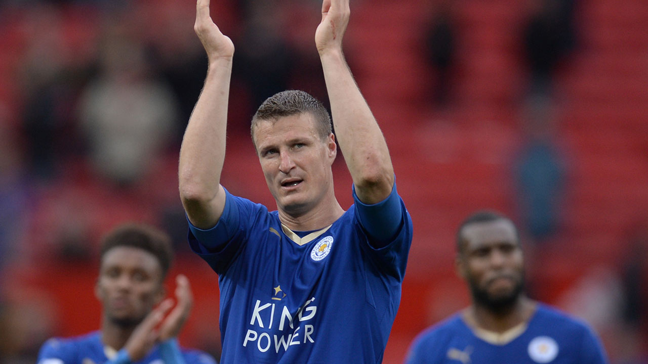 Leicester City's German defender Robert Huth (C) applauds fans after the English Premier League football match between Manchester United and Leicester City at Old Trafford in Manchester, north west England, on May 1, 2016. OLI SCARFF / AFP