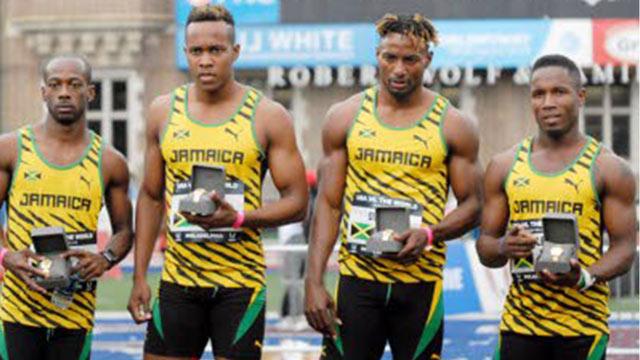 The Jamaica team of (from left) Jermaine Hamilton, Julian Forte, Rasheed Dwyer and Oshane Bailey on the winners podium