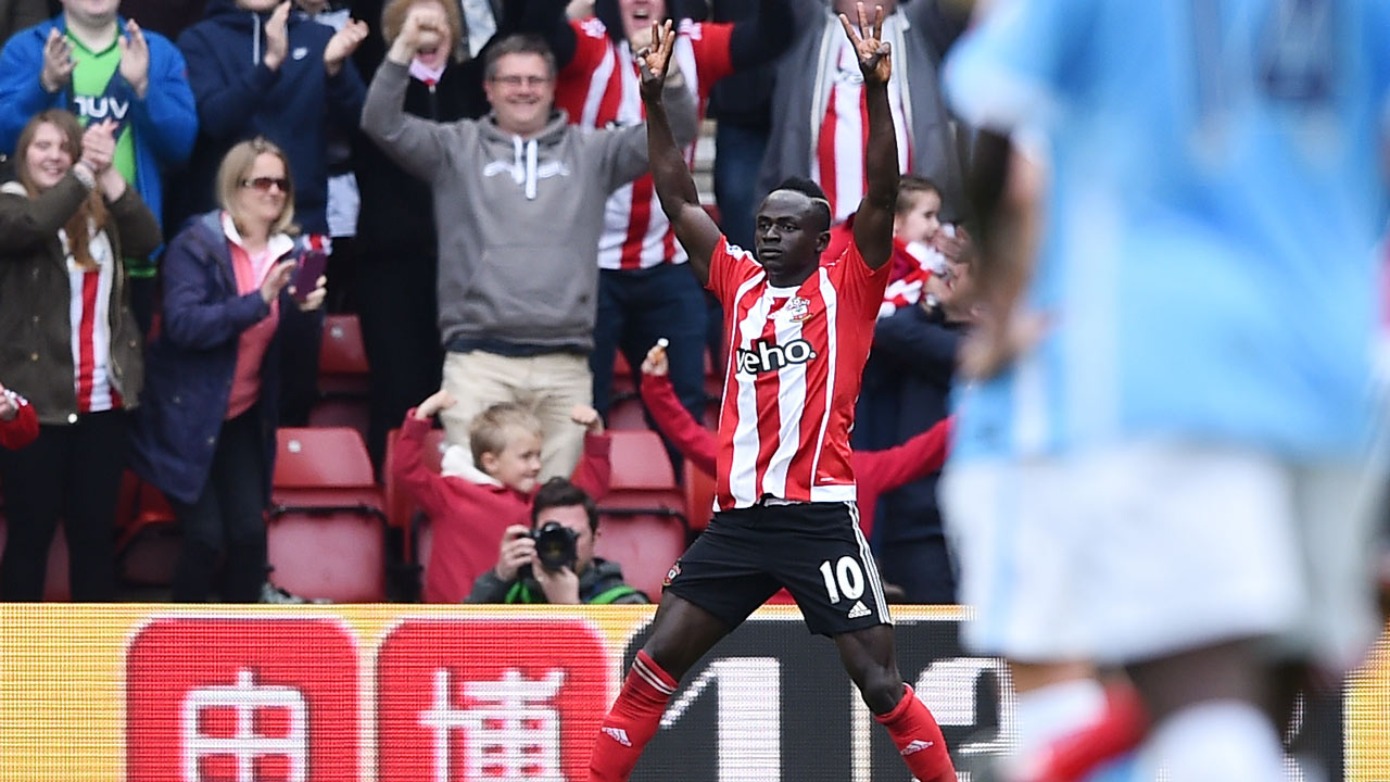 Southampton's Senegalese midfielder Sadio Mane celebrates after scoring a hat trick during the English Premier League football match between Southampton and Manchester City at St Mary's Stadium in Southampton, southern England on May 1, 2016. BEN STANSALL / AFP