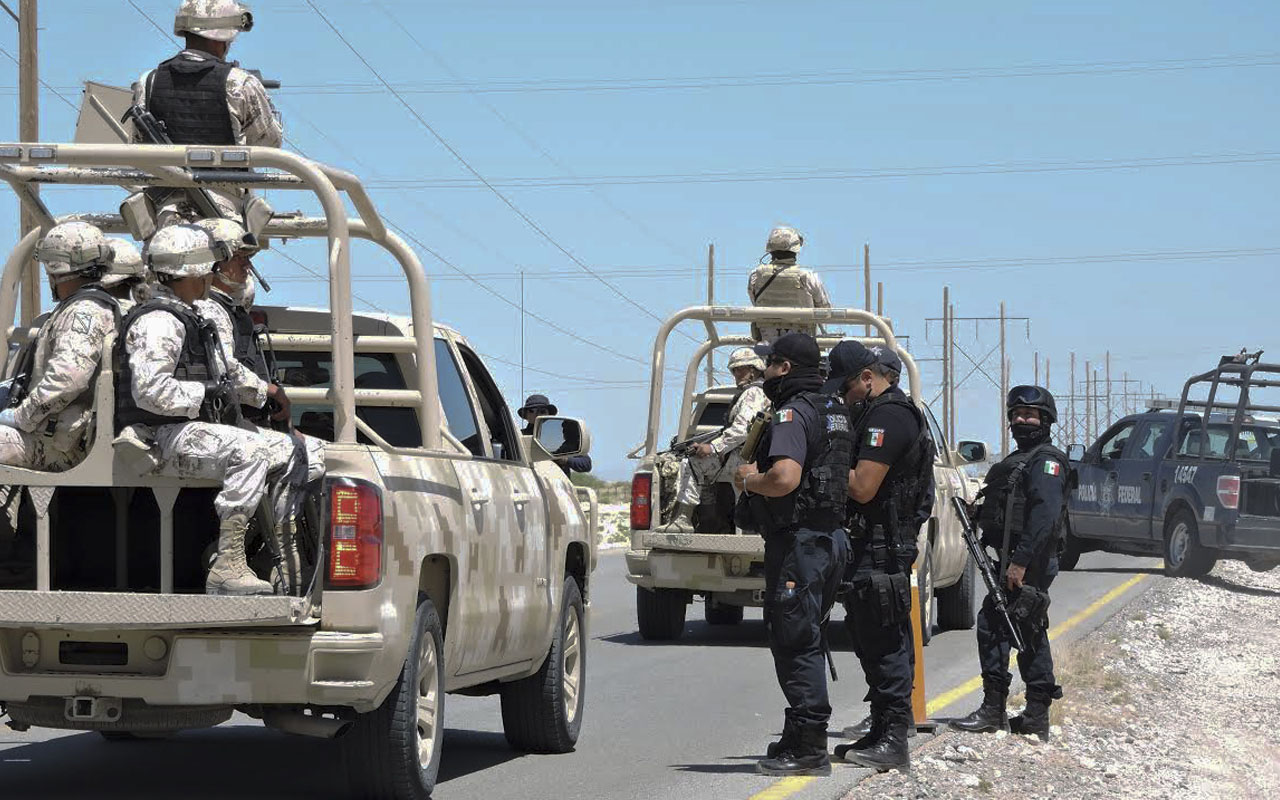 "Members of the Mexican Army and police personnel guard  de road close to the  Ciudad Juatez penitentiary on May 07, 2016.The Mexican authorities transferred the notorious drug lord Joaquin ""El Chapo"" Guzman to a prison in Ciudad Juarez on the US border Saturday morning in a surprise move, officials said.Despite speculation, Guzman's transfer had ""absolutely nothing"" to do with his possible extradition or deportation to the United States -- where he faces extradition requests by courts in California and Texas for homicide and drug trafficking -- authorities told AFP."