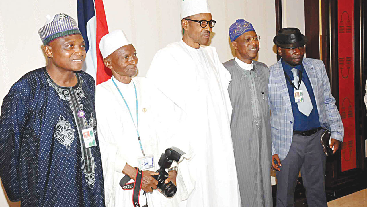 President Muhammadu Buhari (middle); Senior Special Assistant to the President on Media and Publicity, Malam Garba Shehu (left); the oldest journalist in the State House, Alhaji Abubakar Ladan; Minister of Information and Culture, Alhaji Lai Mohammed and the Chairman, State House Press Corps, Kehinde Amodu during a meeting of the president with members of the State House Press Corps in Abuja…yesterday. PHOTO: PHILIP OJISUA