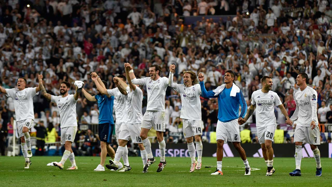 Real Madrid players celebrate their victory at the end of the UEFA Champions League semi-final second leg football match Real Madrid CF vs Manchester City FC at the Santiago Bernabeu stadium in Madrid, on May 4, 2016. Real Madrid won 1-0. GERARD JULIEN / AFP