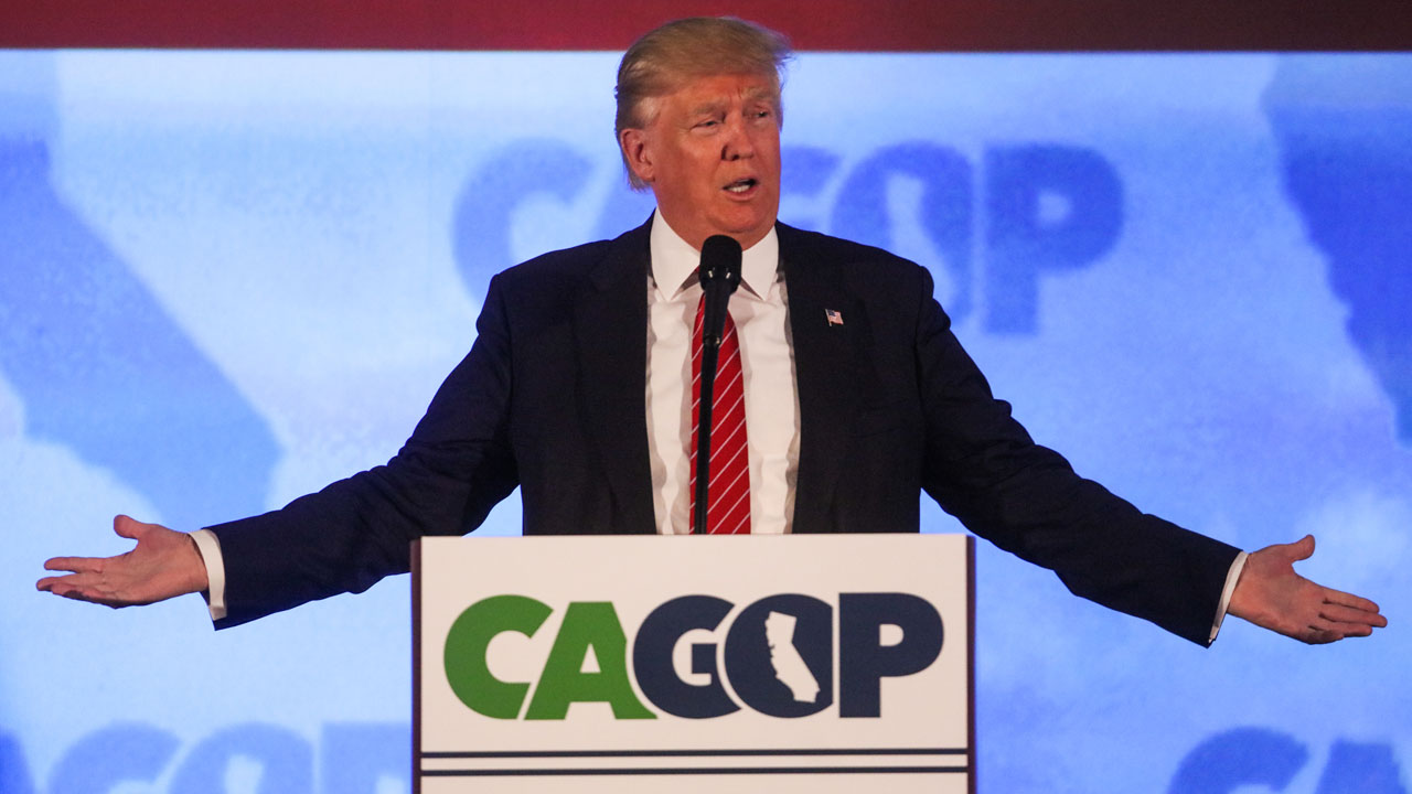 """(FILES) This file photo taken on April 29, 2016 shows US Republican presidential candidate Donald Trump addresses the California Republican Party 2016 Convention in Burlingame, California,  April 29, 2016.  Donald Trump hit out hard at Hillary Clinton and Ted Cruz on May 1, 2016, sounding unapologetic two days ahead of a key primary in Indiana he says will decide the Republican presidential race. Speaking on Fox News Sunday, the Republican frontrunner concentrated on attacking Clinton, doubling down on his much-criticized statement that the likely Democratic nominee's only appeal to voters is the """"woman's card.""""  / AFP PHOTO / GABRIELLE LURIE"""