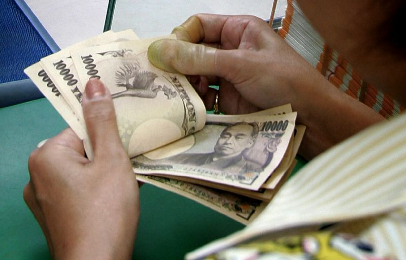 The dollar bought 120.24 yen, compared with 120.54 yen in New York where it at one point earlier it broke 121 yen (AFP Photo/Kazuhiro Nogi)