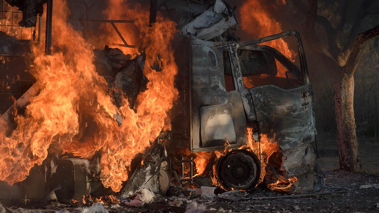 Residents from Atteridgeville, west of Pretoria, have set a truck alight due to their dissatisfaction with the South African ruling party African National Congress (ANC) nominations on the candidates list for the upcoming municipal elections, on June 21, 2016 in Pretoria. MUJAHID SAFODIEN / AFP