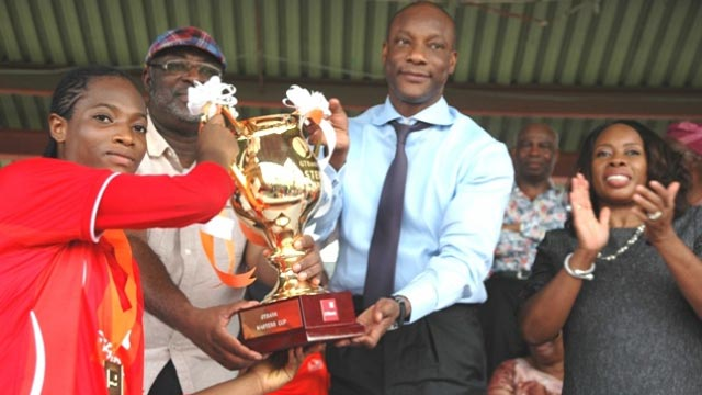 Managing Director, GTBank Mr Segun Agbaje (2nd right) presenting trophy to captain of winning female side, Queens College Yaba.