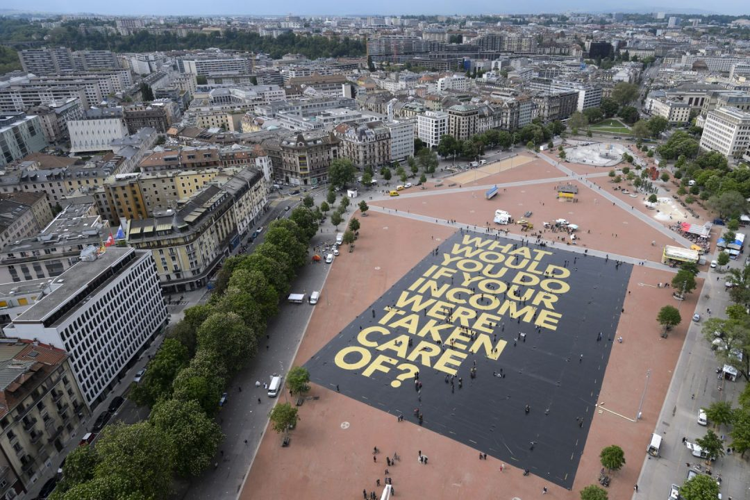 "This photo taken on May 14, 2016 in Plainpalais place in Geneva shows a giant poster reading ""What would you do if your income was taken care of?"", setting the Guinness World Record for the largest poster ever printed. Photo: AFP"