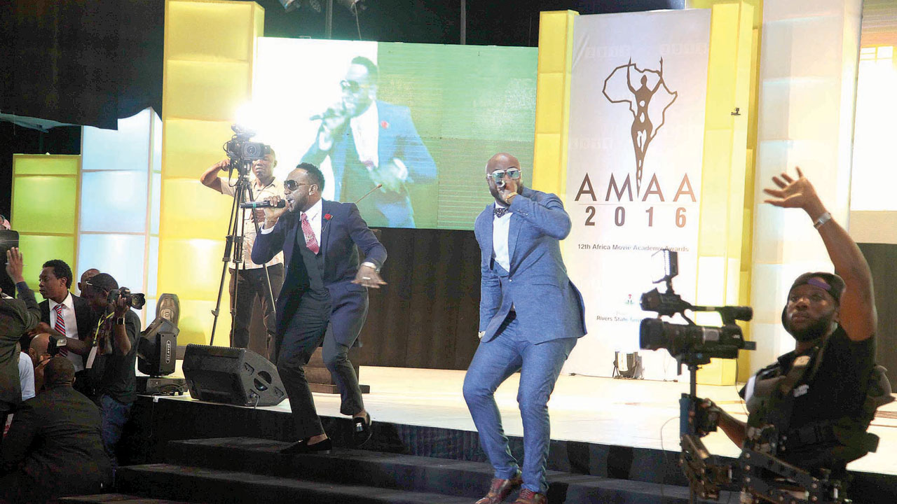 Kcee and Harrysong performing at the AMAA award in Port Harcourt.