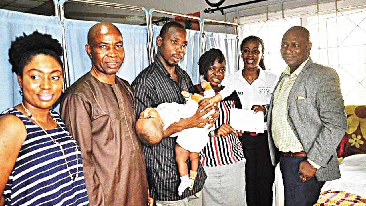 Events & Sponsorships Coordinator Arik Air, Diana Ekpenyong (left); Public Relations (PR) & Communications Manager Arik Air, Adebanji Ola; Father of conjoined twins, Ayeni Samuel Olusegun; Mother of Conjoined twins, Mrs. Ayeni Mary Abiodun; Founder Linking Hands Foundation, Efe Farinre; and Associate Vice President Marketing and Communications, Arik Air, Jide Alade, during the presentation of return tickets to New York, United States (U.S.), for conjoined twins, Miracle and Testimony Ayeni at Lagos State University Teaching Hospital, Ikeja over the weekend.