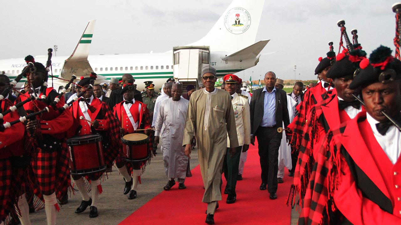 Image result for President Buhari returns to Abuja, inspects Presidential Guard of Honour
