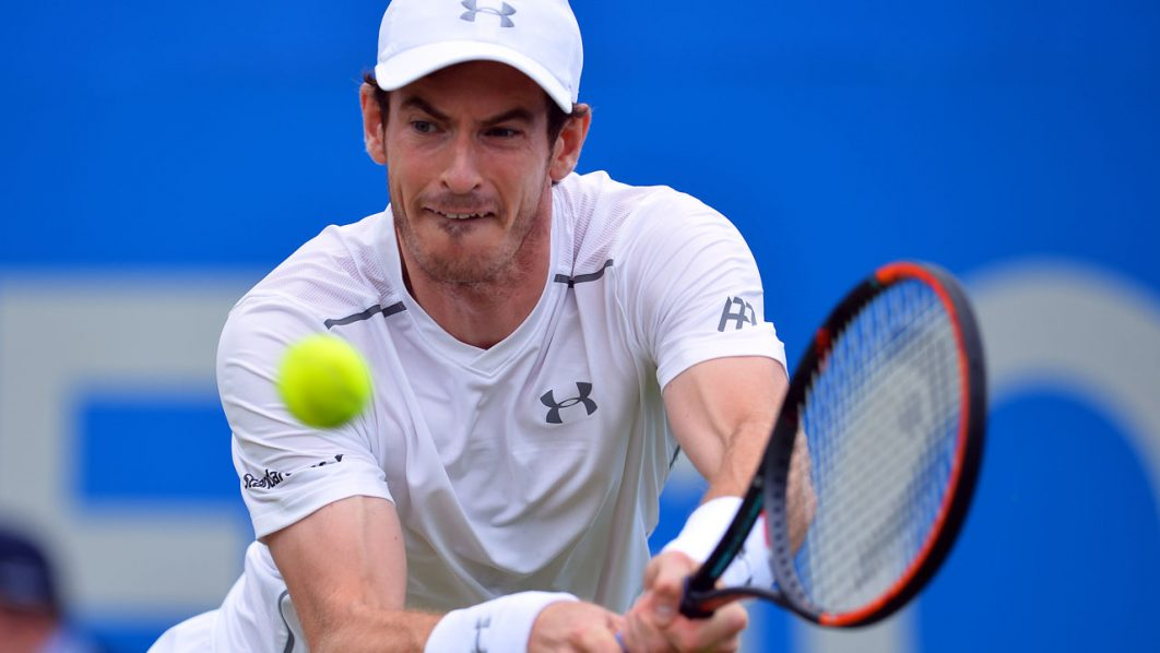 Britain's Andy Murray returns to Britain's Aljaz Bedene during their match at the ATP Aegon Championships tennis tournament at Queen's Club in west London on June 16, 2016.  / AFP PHOTO / GLYN KIRK