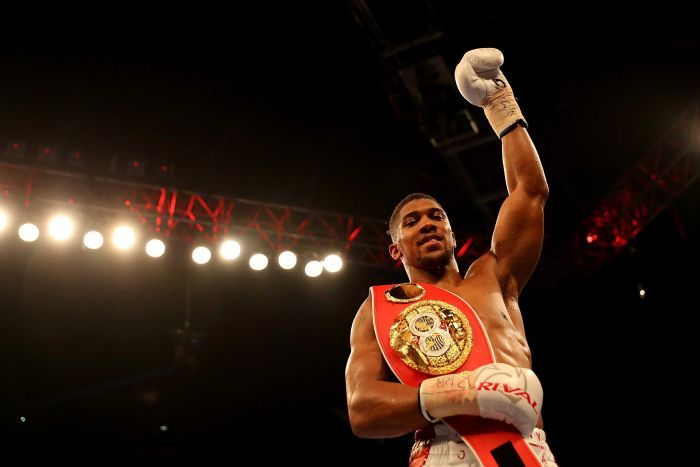 Anthony Joshua celebrates after defending his IBF heavyweight title. AFP/Getty Images/Richard Heathcote