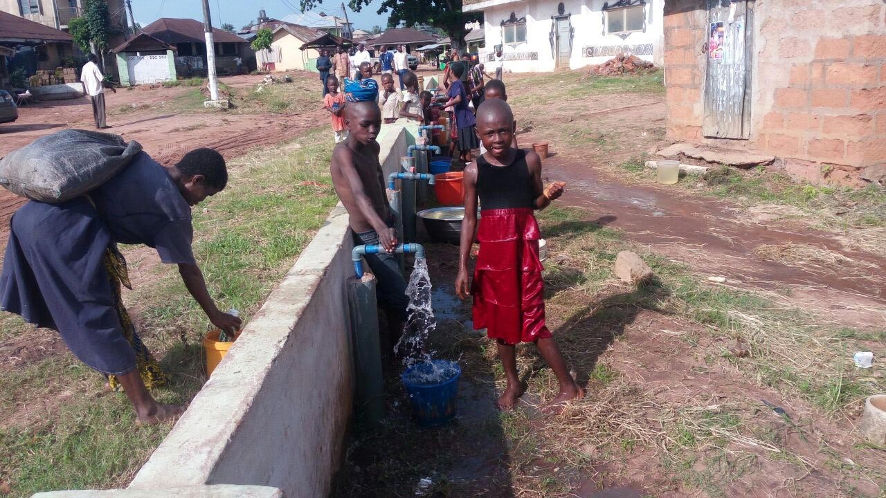Residents of Ekeluogo Ohafia community, Abia State, accessing water from the borehole provided by the lawmaker representing Arochukwu/Ohafia Federal Constituency, Chief Uko Nkole.