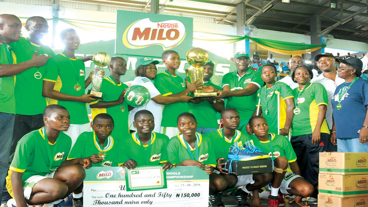 Wesley Girls Senior Secondary School, Lagos, celebrating with Nestle Milo officials after winning the girls' category of the Milo Secondary Schools Basketball Championship in Asaba…at the weekend.