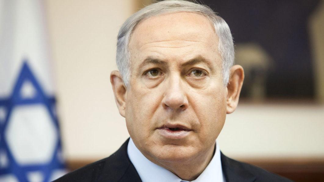 Israeli Prime Minister Benjamin Netanyahu looks on as he chairs the weekly cabinet meeting in his Jerusalem office on June 26, 2016. / AFP PHOTO / POOL / Dan Balilty
