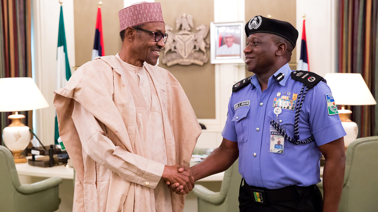 New acting inspector-general of police Mr Ibrahim Kpotun Idris (right) being congratulated by President Muhammadu Buhari at the State House Abuja PHOTO: PHILIP OJISUA