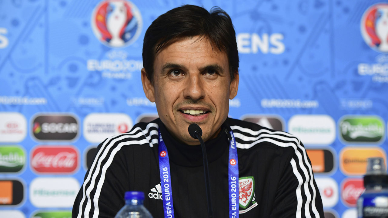 This UEFA handout image taken on June 15, 2016 taken in Lens shows Wales coach Chris Coleman attending a press conference on the eve the Euro 2016 football match England against Wales. / AFP PHOTO / UEFA / Handout /