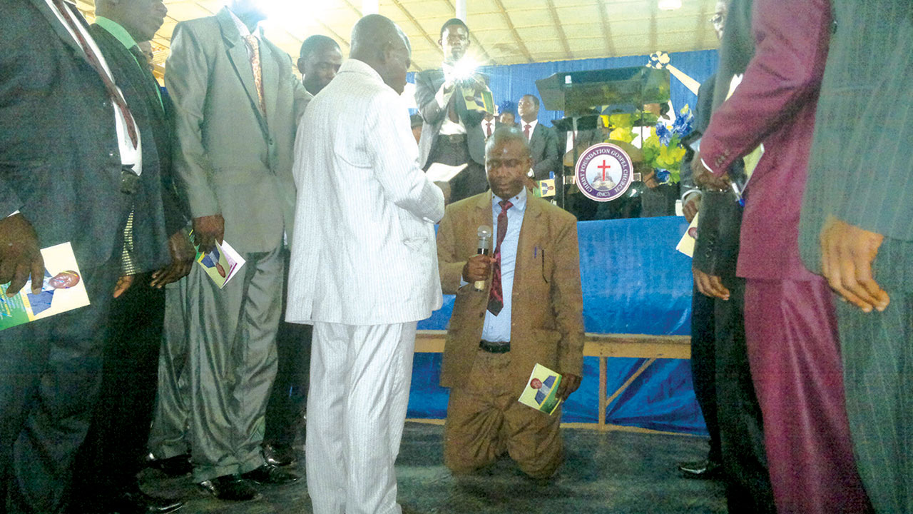 Revd. Nathaniel Awofe Akintobi (kneeling) during the installation