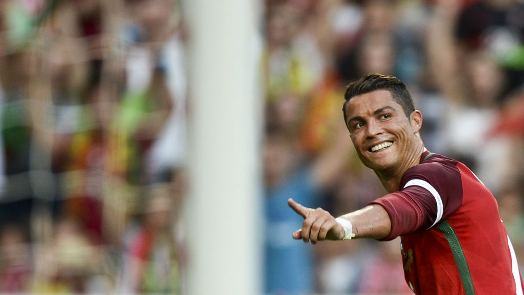 Portugal's forward Cristiano Ronaldo celebrates after scored against Estonia during the friendly football match Portugal vs Estonia at Luz stadium in Lisbon on June 8, 2016, in preparation for the upcoming UEFA Euro 2016 Championship. / AFP PHOTO / PATRICIA DE MELO MOREIRA