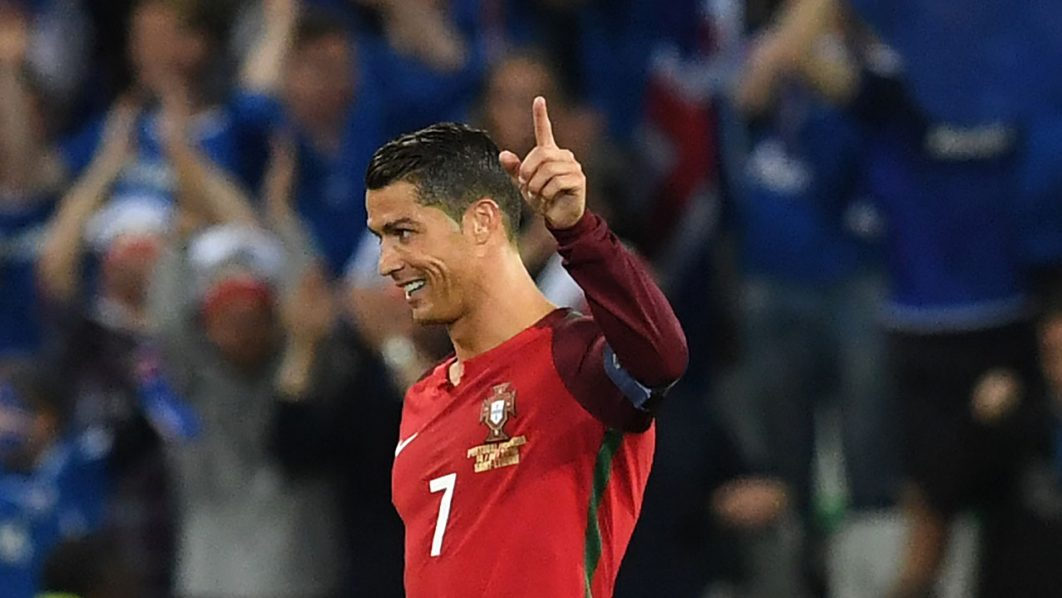 Portugal's forward Cristiano Ronaldo reacts during the Euro 2016 group F football match between Portugal and Iceland at the Geoffroy-Guichard stadium in Saint-Etienne on June 14, 2016. / AFP PHOTO / FRANCISCO LEONG