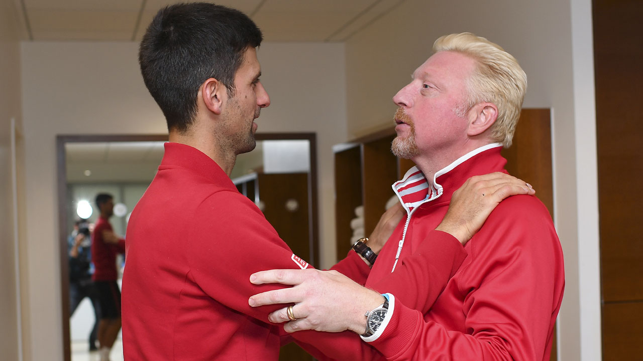 "Djokovic (L) speaking to his coach former German tennis player Boris Becker in the locker room after winning the men's final match against Britain's Andy Murray at the Roland Garros 2016 French Tennis Open in Paris on June 5, 2016. / AFP PHOTO / FEDERATION FRANCAISE DE TENNIS / NICOLAS GOUHIER / ""AFP PHOTO / FEDERATION FRANCAISE DE TENNIS / NICOLAS GOUHIER """