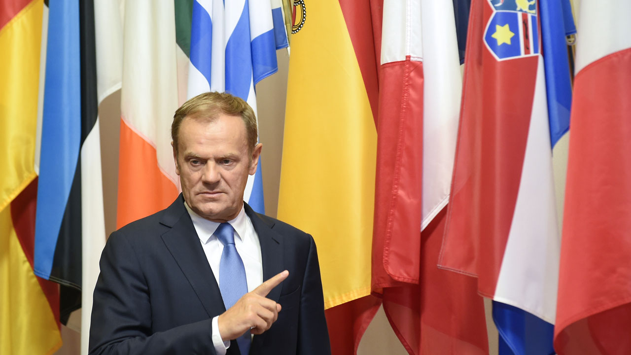 EU Council President Donald Tusk gestures as he arrives for a meeting with Slovakian Prime minister Robert Fico at the EU headquarters in Brussels on June 1, 2016.  Slovakia is taking the EU presidency from June 1 to December 31.  / AFP PHOTO / JOHN THYS