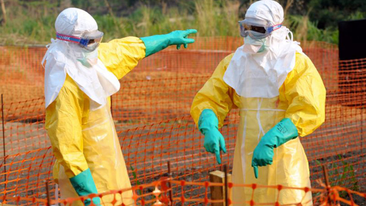 Ebola workers wear protective gear at an isolation ward in Guinea, where the deadly virus emerged in December 2013 (AFP Photo/Seyllou)