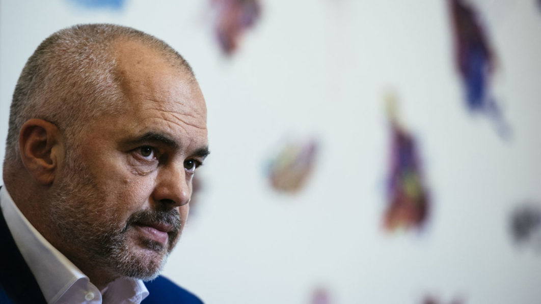 Albanian Prime Minister Edi Rama speaks during an interview in Tirana on June 28, 2016.   When Albanian Prime Minister Edi Rama wrote to the London Times about the risk of Brexit, his message was clear -- and echoed other Balkan nations desperate to join the European Union. / AFP PHOTO / DIMITAR DILKOFF
