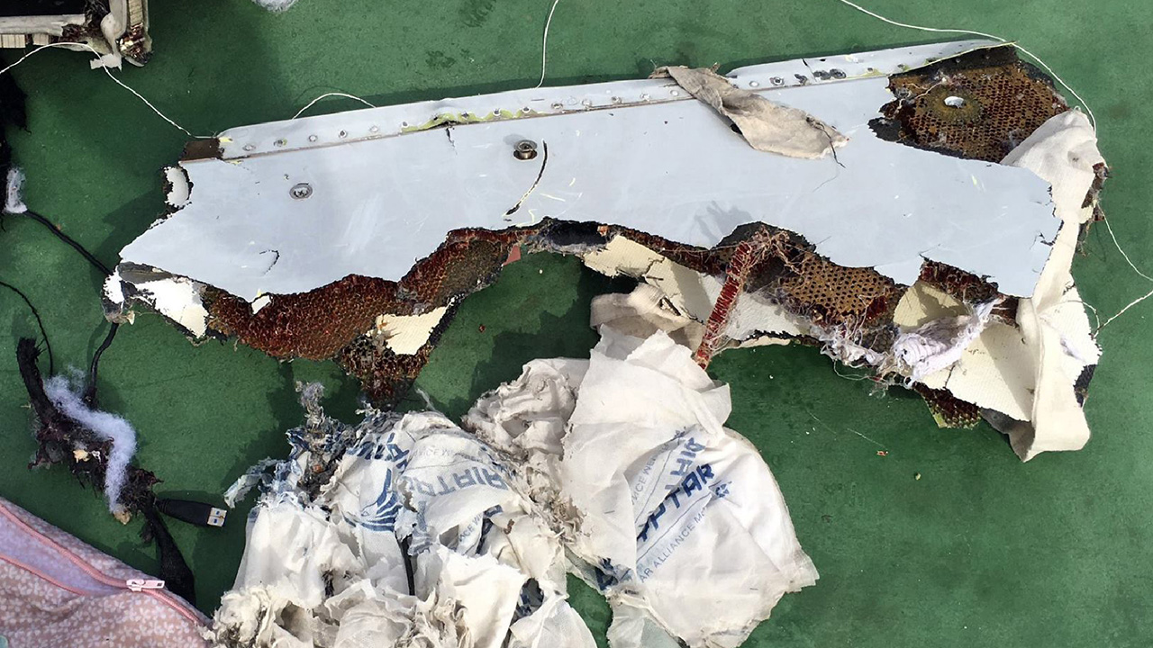 "(FILES) This picture uploaded on the official Facebook page of the Egyptian military spokesperson on May 21, 2016 and taken from an undisclosed location reportedly shows some debris that the search teams found in the sea after the EgyptAir Airbus A320 crashed in the Mediterranean. Pieces of the cabin from the missing EgyptAir plane which crashed into the Mediterranean last month have been found, Egyptian investigators said on June 15, 2016. The pieces of fuselage were found at ""several sites"", the Egyptian board of inquiry, said in a statement. The Airbus A320 which had been en route from Paris to Cairo disappeared on May 19, with the loss of all 66 people on board. / AFP PHOTO / Egyptian military spokesperson's facebook page / HO"