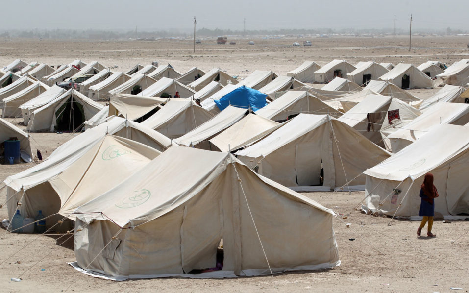 Tents sheltering Iraqis displaced from the city of Fallujah are seen at a newly opened camp in Amriyat al-Fallujah on June 27, 2016, south of Fallujah. Iraqi forces on June 26 wrapped up operations in Fallujah and declared the area free of jihadists from the Islamic State (IS) group after a month-long operation. The government said the destruction caused by the fighting was limited and vowed to do its utmost to allow the tens of thousands of displaced civilians to return to their homes.  / AFP PHOTO / AHMAD AL-RUBAYE