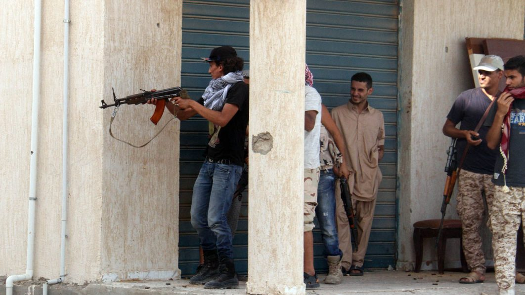 Forces loyal to Libya's UN-backed unity government clash with jihadists in the city of Sirte, 450 kilometres (280 miles) east of Tripoli, during an operation to recapture the city from the Islamic State (IS) group, on June 12, 2016. Forces allied with Libya's unity government, who entered Sirte on June 8 and have been advancing more quickly than expected against IS, which seized control of the coastal city last year and turned it into its main base of operations in North Africa, have faced fierce resistance including a series of suicide car bombings. / AFP PHOTO / STRINGER