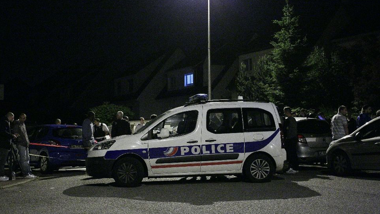 Police investigate the scene after a man stabbed a police officer to death before being shot dead on June 14, 2016 in Magnanville, a suburb of Paris PHOTO: AFP Photo/Matthieu Alexandre