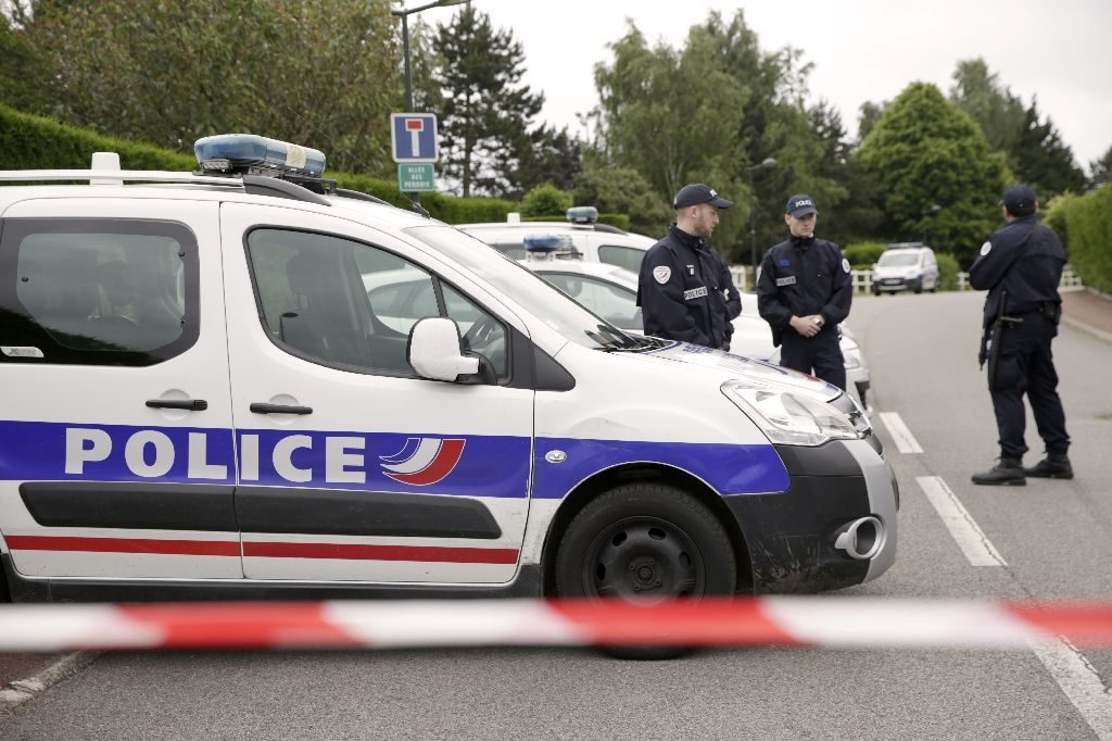 French police cordon off a street in Magnanville after a man claiming allegiance to the Islamic State group killed two people on June 13, 2016. PHOTO: AFP/ THOMSON SAMSON
